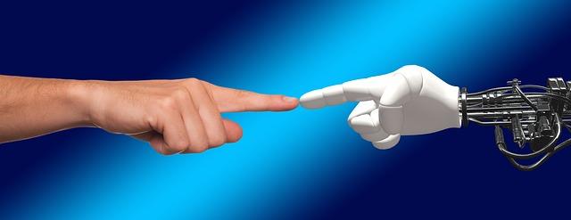 https://pixabay.com/de/hand-roboter-mensch-g%C3%B6ttlich-funke-1571852/